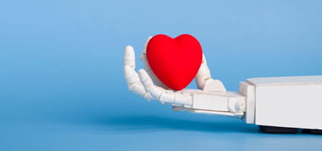 Robot hand holding model heart