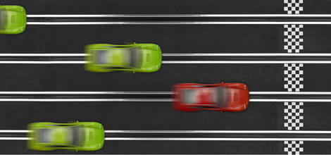 Cars racing for finish line